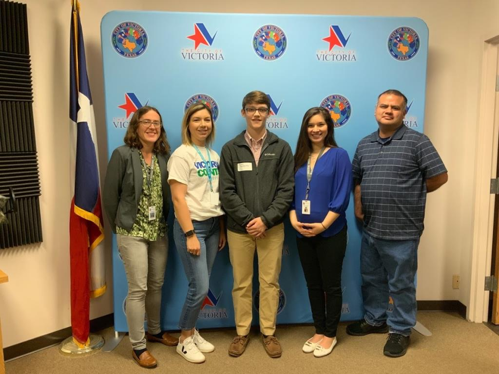 Communications & Public Affairs staff with VISD student John Andruss
