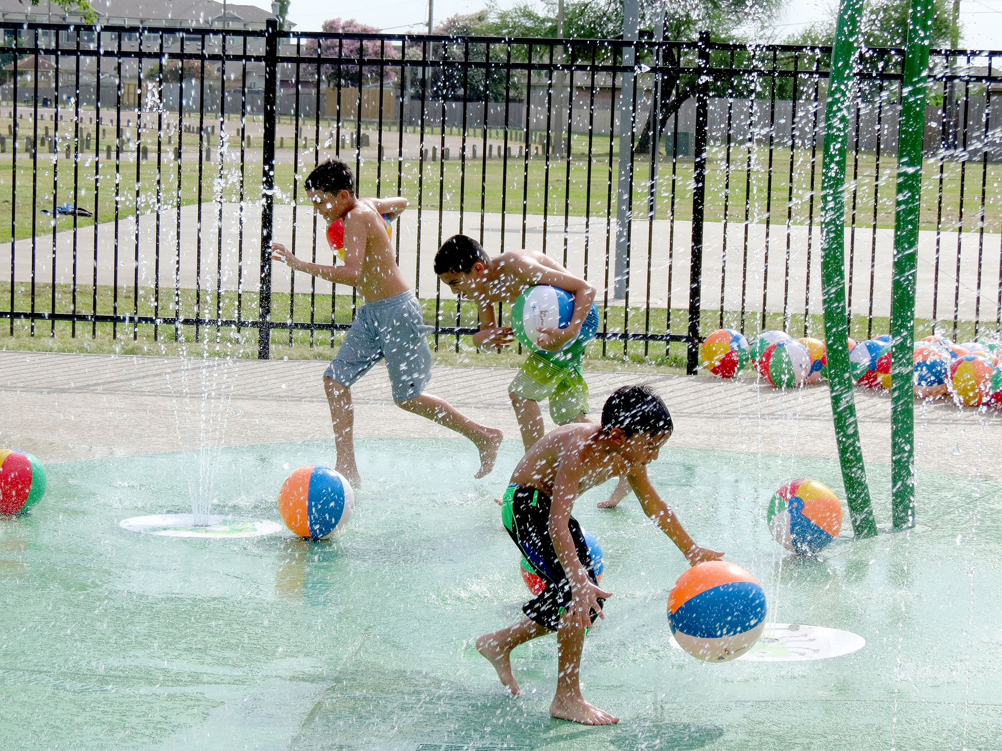 Children play at the Ethel Lee Tracy Park Splash Pad.