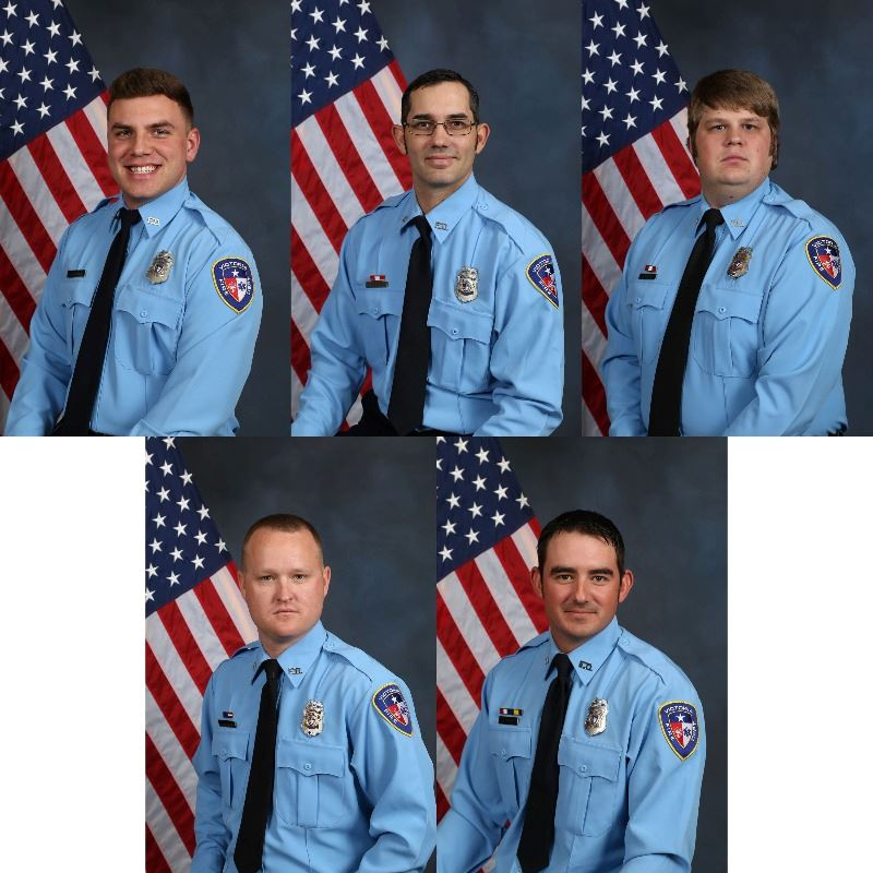 Portraits of five Victoria Fire Department employees in uniform with American flags