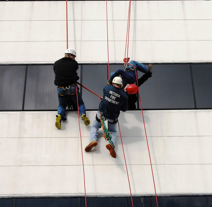 Three Fire Department members participate in High Angle Rescue Training