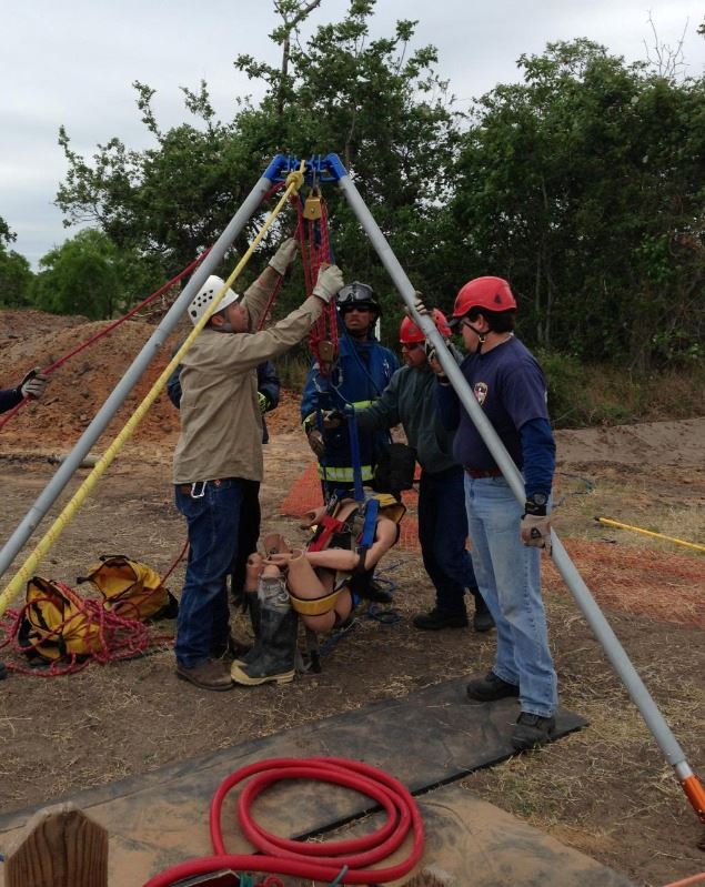 Four Fire Department Members participate in a Confined Space Rescue Training Drill