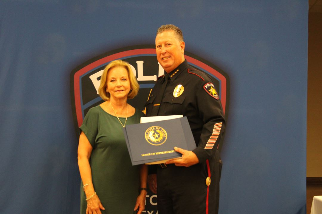 State Representative Geanie Morrison presents Victoria Police Department Chief J.J. Craig with an Am